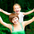 Stock Photo: Smiling Mother and daughter