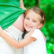 Girl hugging mother's belly — Stock Photo #11986880