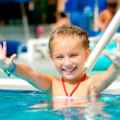 Girl in the pool — Stock Photo #12140379