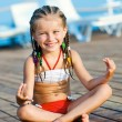 Girl in a yoga pose — Stock Photo #12140418