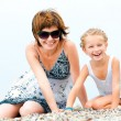 Mother with daughter on the seashore — Stock Photo #12140488