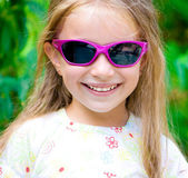 Girl in violet sunglasses — Stock Photo