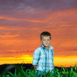 Happy young man rest on green field — Stock Photo