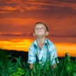 Stock Photo: Happy young man rest on green field