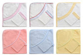 Collection of bathing baby towels on a white background — Stock Photo