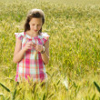 Young beautiful girl in a field of wheat — Stock Photo #12113289