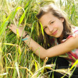 Young beautiful girl in a field of wheat — Stock Photo #12226897