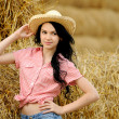 Beautiful girl enjoying the nature in the hay — Stockfoto