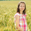 Young beautiful girl in a field of wheat — Stock Photo #12377758