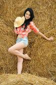Beautiful girl enjoying the nature in the hay — Stock Photo
