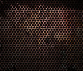 Rusty hexagonal metal grille — Stock Photo