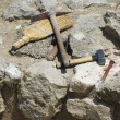Archaeologist tools on excavation site - Stock fotografie
