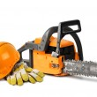 Chain saw and safety gear — Stock Photo