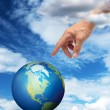 Royalty-Free Stock Photo: Hand reaching planet Earth
