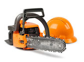 Chain saw and safety helmet — Stock Photo
