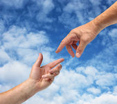 Two hands reaching each other — Stock Photo