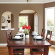 Dining room with brown walls and wood table. — Stock Photo #10919511