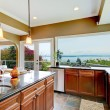 Modern luxury kitchen with water view and sink. - Zdjcie stockowe
