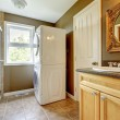 Royalty-Free Stock Photo: Laundry room with bathroom cabinet and sink.