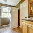 Laundry room with bathroom cabinet and sink. - Stock Photo
