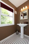 Brown small bathroom with antique sink and tiles. — Stock Photo