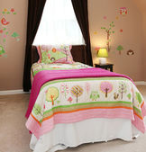 Baby girl kids bedroom with pink bed and brown walls. — Stock Photo