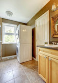 Laundry room with bathroom cabinet and sink. — Stock Photo