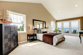 Classic luxury large bedroom with water view and carpet. — Stock Photo