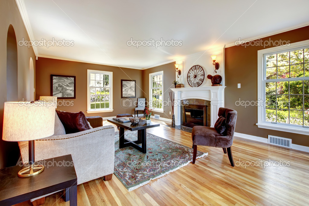 Classic brown and white living room with hardwood floor. | Stock ...