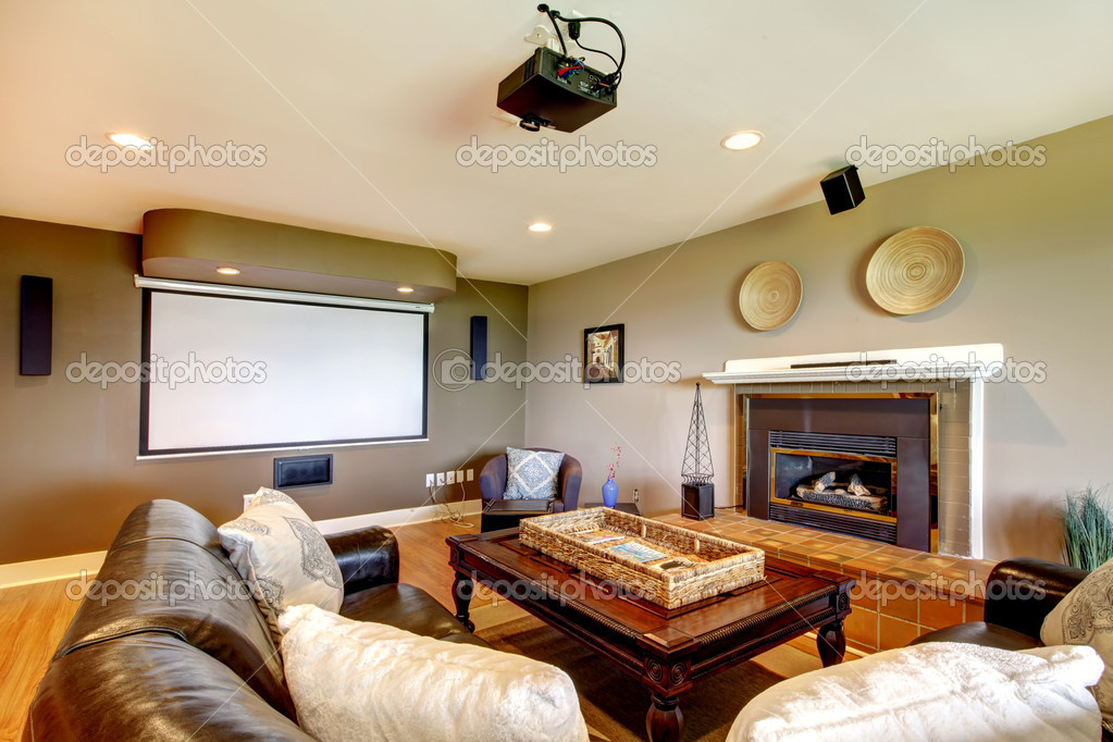 Clasic Living room with projector screen and fireplace.  Stock Photo #10919746