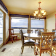Dining room with water view and large windwos and doors. — Stock Photo