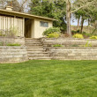 Retaining brick with steps wall with garage building. — Stock Photo #11404349