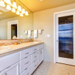 Large bathroom with white cabinets and glass shower. — Foto Stock
