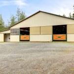Horse arena exterior building with two lareg gates. — Stock Photo