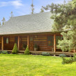 Rustic log cabin front porch exterior. — Stock Photo