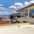 Modern house with patio and view of Seattle and water. — Stock Photo #11405150