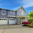 Grey American house with two garage doors. — Stock Photo #11406208