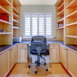 Small home office with shelves and desk. — Stock Photo