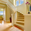 Royalty-Free Stock Photo: Beautiful home staircase design with hardwood floors.