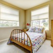 SImple guest bedroom with wood old bed. - Stock Photo