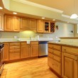 Golden wood kitchen with granite and stainless steal. - Stock Photo