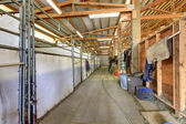 Horse arenam interior with wood beans and stables. — Stock Photo