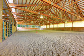 Large horse arena riding area with sand interior. — Stock Photo