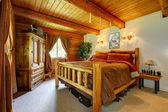 Cowboy bedroom interior with wood ceiling. — Stock Photo
