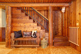 Rustic log cabin stairace and bench details. — Stock Photo