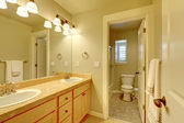 Classic two sink bathroom in beige color. — Stock Photo