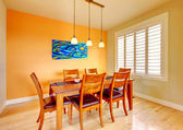 Dining room with blue painting and wood table. — Stock Photo