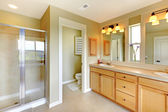 Beautiful classic bathroom with double sink and shower. — Stock Photo