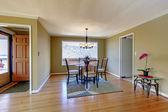 Dining room with flont door and hardwood floor. — Stock Photo
