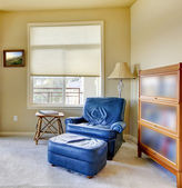 Blue chair in the corner with lamp interior. — Stock Photo